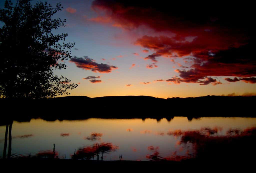 Sunset over lake with reflection