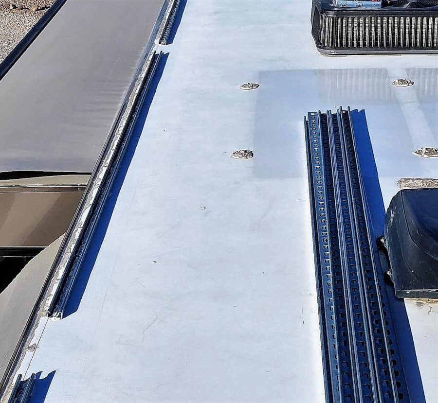 Slot tracks installed on the edge of the RV roof.