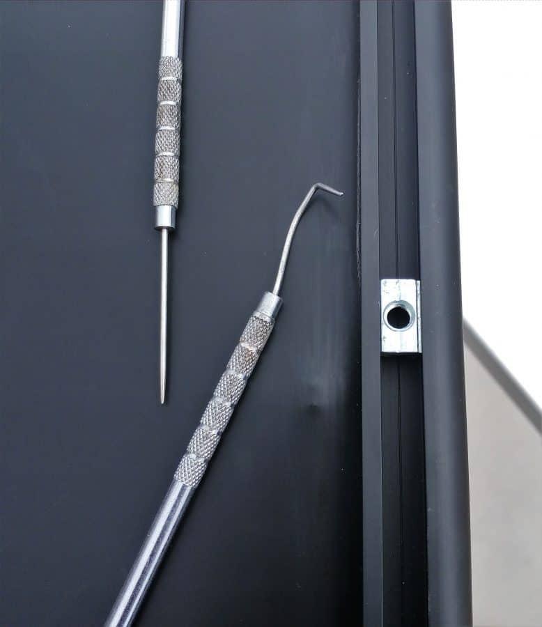 Zamp Obsidian Solar Panel with T-slot nut and dental picks.