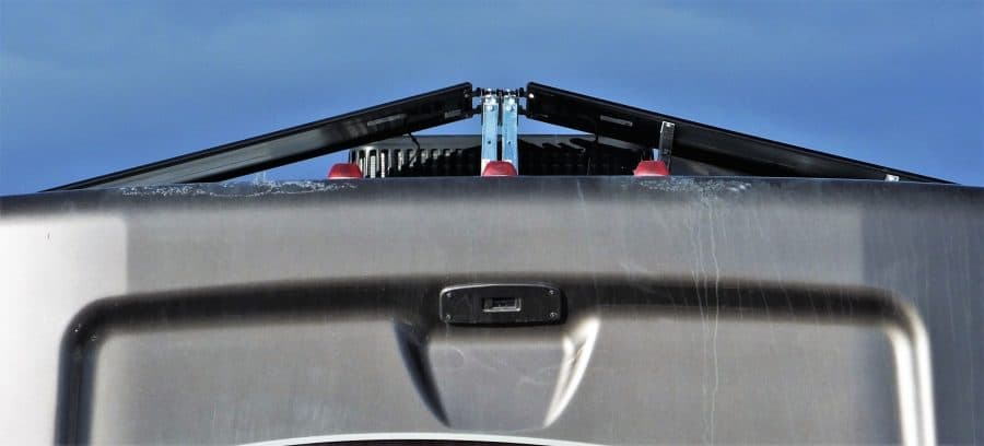Picture of the rear of the RV and the solar panels in the lower (stowed) position.