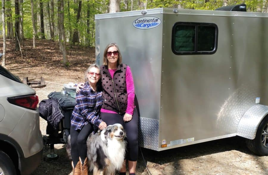 Tami, Kaitland, and Obi Wan, with the tiny camper she invented.