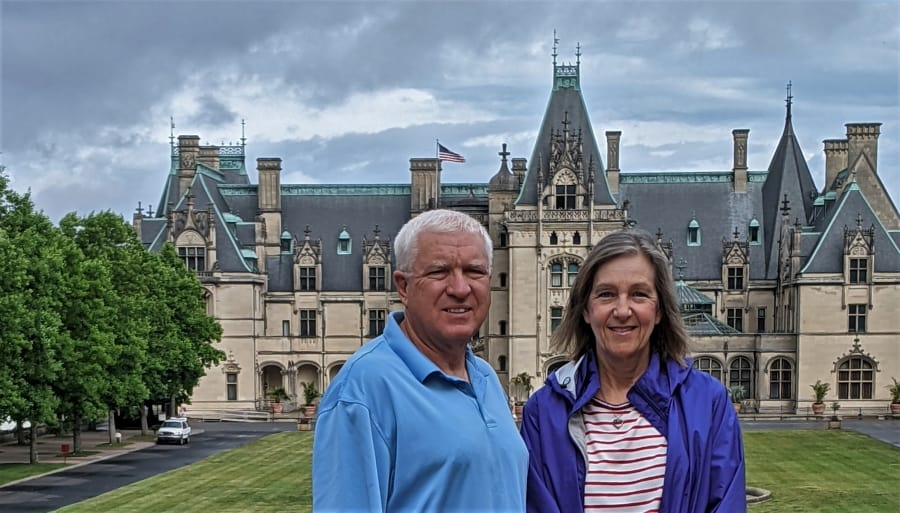 Scott and Tami standing on the Rampe Douce in front of the Amazing Biltmore Palace.