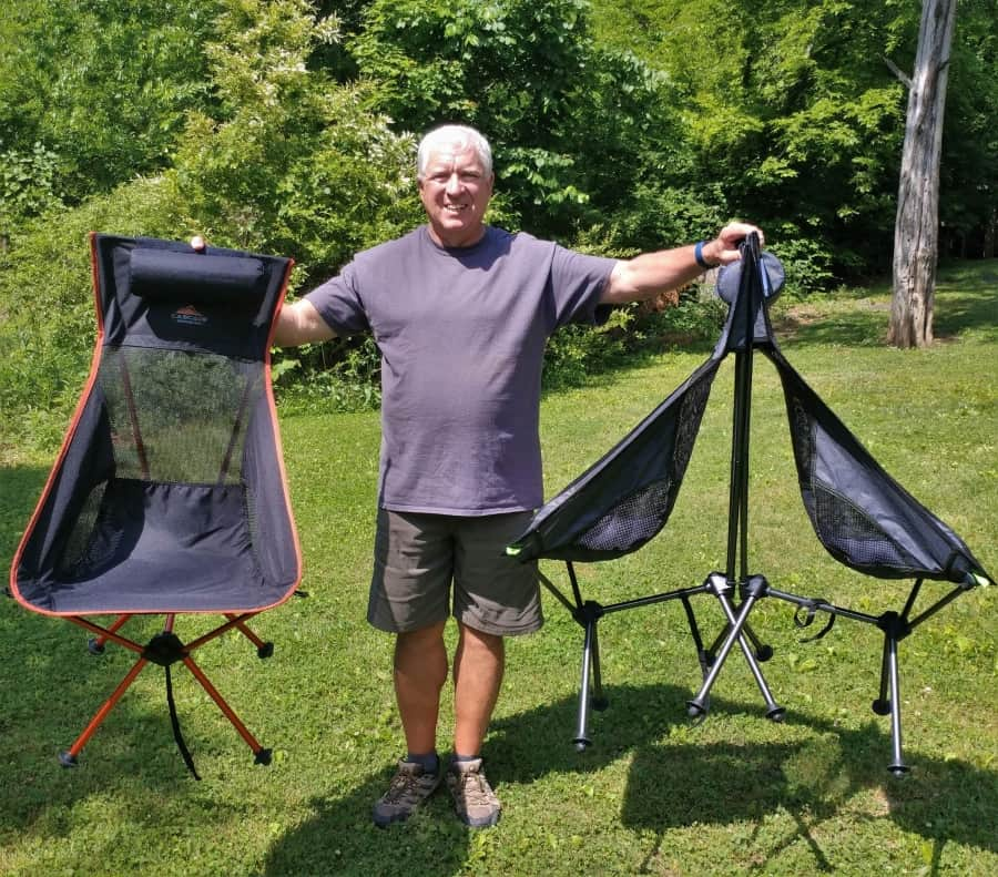 Holding three Cascade MountainTech Ultra Light camp chairs.