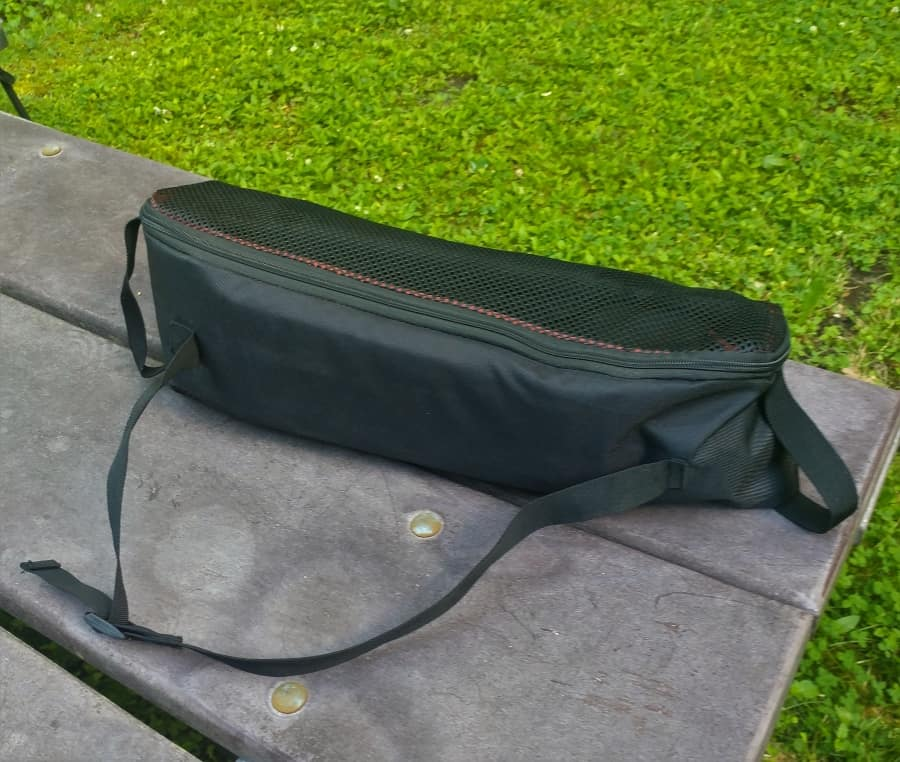 A Cascade MountainTech Ultra Light camp chair in it's bag with carry sling..