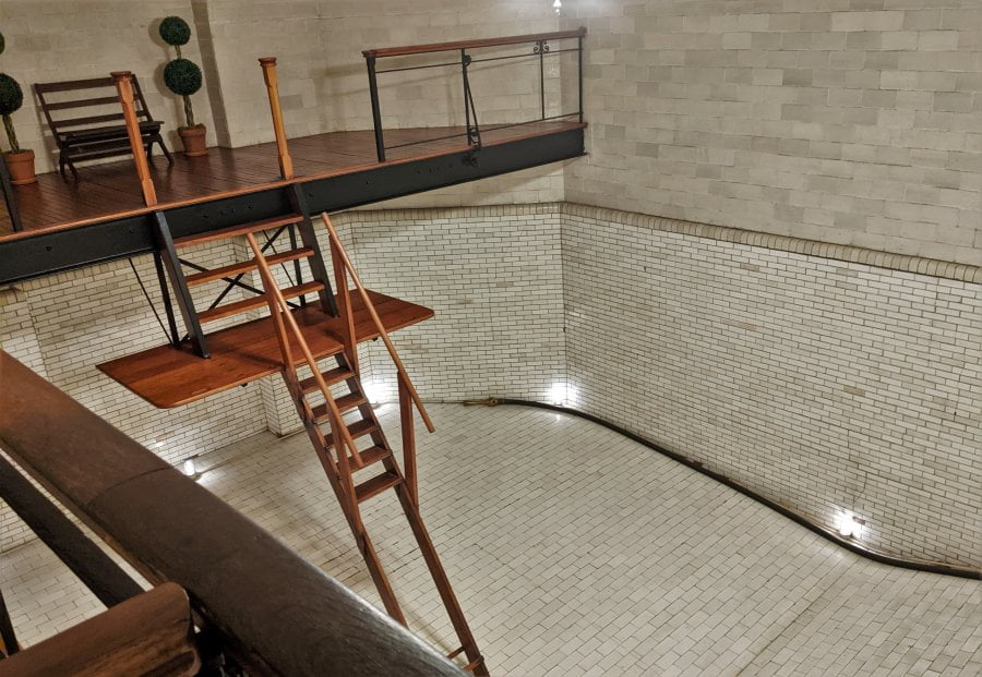 The indoor pool with diving platform.