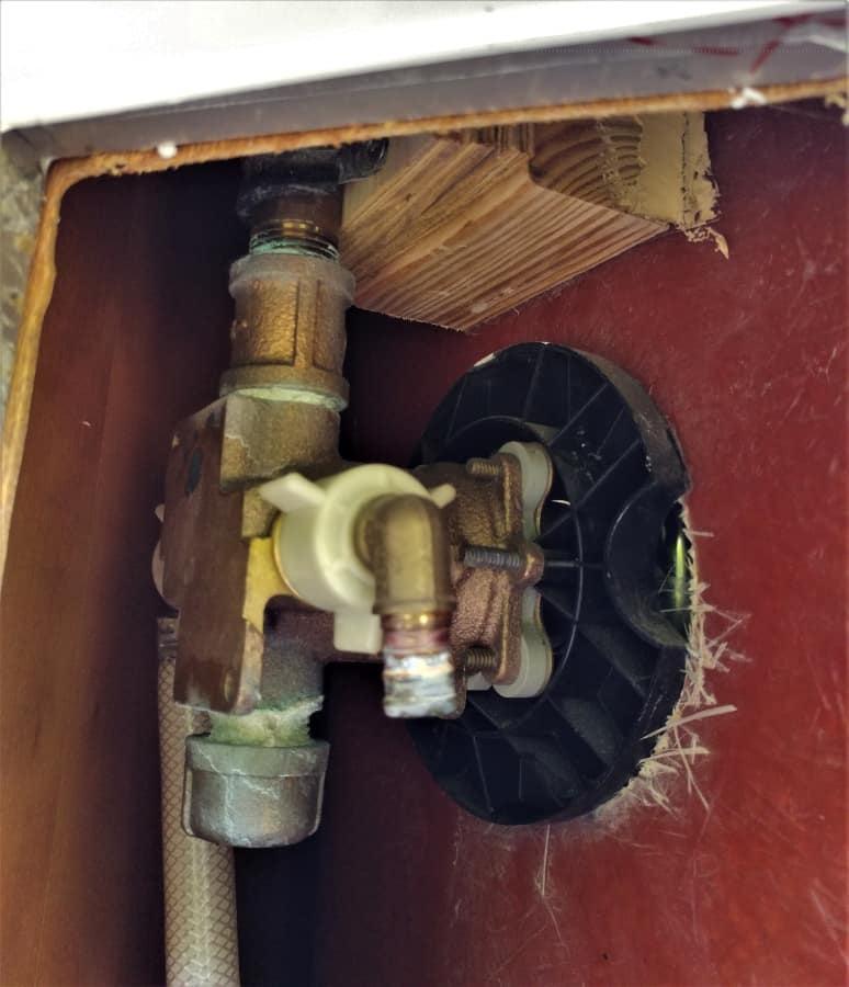 Broken plumbing behind our shower.