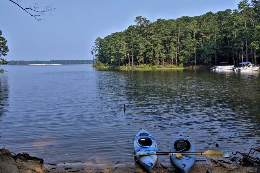 Our kayaks on our private beach behind our RV at Lake Jordan