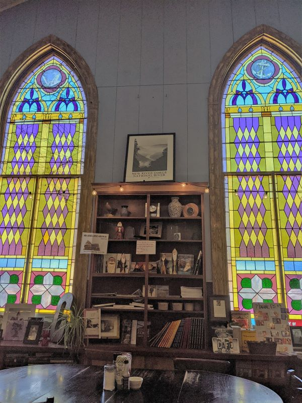 Stained glass windows inside a church converted into a coffee house.